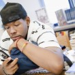 High School Student Using Cell Phone In Library — Stock Photo