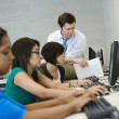 Teacher Helping Students In Computer Lab — Stock Photo