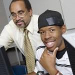 High School Teacher Helping Student — Stock Photo