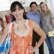 Happy Customers In Clothing Store — Stock Photo