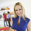 Beautiful Saleswoman With Customers In Background — Stock Photo