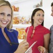 Saleswoman And Couple At Store — Foto de Stock