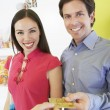 Couple Paying For Purchase With Credit Card — Stock Photo
