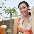 Woman Using Cell Phone In Restaurant — Stock Photo #21863041