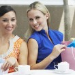 Women With Shopping Bags At Cafe — Stock Photo