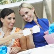 Stock Photo: Female Friends Toasting Coffee Cups