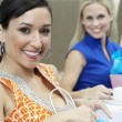 Female Friends With Shopping Bags At Restaurant — Foto de Stock