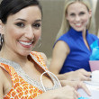 Female Friends With Shopping Bags At Restaurant — Stockfoto