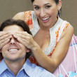 Woman Holding Hands Over Man's Eyes — Stock Photo