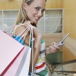 Woman With Shopping Bags Text Messaging — Foto de Stock