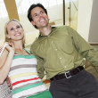 Happy Couple With Shopping Bags On Staircase — Stock Photo