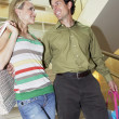 Happy Couple With Shopping Bags In Mall — Stock Photo