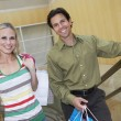 Stock Photo: Happy Couple Carrying Shopping Bags