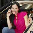 Cheerful Woman Sitting In Convertible Using Cell Phone — Stok fotoğraf