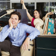 Man With Shopaholic Woman In Convertible — Stock Photo
