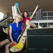Stock Photo: Shopaholic Female Friends In Convertible