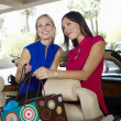 Female Friends Holding Shopping Bags — Stock Photo