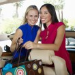 Cheerful Women With Shopping Bags In Convertible — Stock Photo