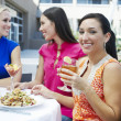 Stock Photo: Female Friends Enjoying At Restaurant