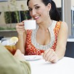 Beautiful Woman Enjoying a Date In a Cafe — Stock Photo