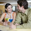 Couple With Martinis At Bar Counter — Stock Photo