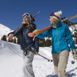 Skiers Carrying Skis on Snowy Landscape — Stock Photo