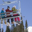 Three Skiers On Chair Lift — Stock Photo