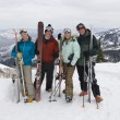 Skiers On Mountain Holding Skis - Stock Photo