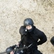 SWAT Team Officer Rappelling and Aiming Gun — Foto de stock #21863657