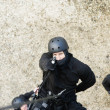 SWAT Team Officer Rappelling and Aiming Gun - Stock Photo