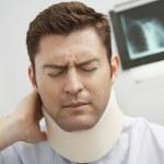 Man In Pain Wearing Neck Brace — Stock Photo