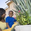 WomAnd Son Tending Plants — Stock Photo #21865753