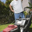 Man Looking At Lawn Mower — Stock Photo