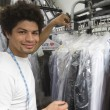 Stockfoto: Young MWorking In Dry Cleaning