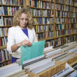 Woman Shopping In Music Store — Stock Photo #21865965