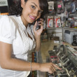 Female Owner Using Cell Phone At Mobile Store — Stock Photo #21866037
