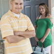 Couple Standing At Doorway — Stock Photo