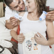 Expectant Couple With Baby Clothes — Stok fotoğraf