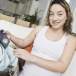 Expectant Woman Packing Baby Clothes — Stock Photo