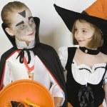 Girl And Boy Wearing Halloween Costumes — Stock Photo