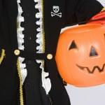 Boy In Halloween Outfit Holding Pumpkin Bucket — Stock Photo #21866359