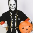 Boy In Grim Reaper's Outfit With Pumpkin Bucket — ストック写真