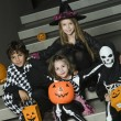 Kids In Halloween Costumes Sitting On Stairs — Foto de Stock