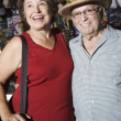Stock Photo: Happy Senior Couple At Souvenir Shop