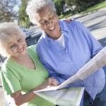 Two Happy Senior Women Reading Map — Stock Photo
