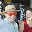 Senior Couple Trying Sunglasses At Shop — Stock Photo