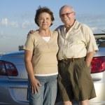 Senior Couple Standing Against Car — Stock Photo