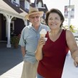 Senior Couple With Woman Holding Ice-Cream — Stock Photo