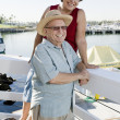 Stock Photo: senior couple spending vacation at harbor