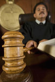 Judge Using Gavel In Courtroom — Stock Photo